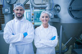 Food technicians smiling at camera — Stock Photo
