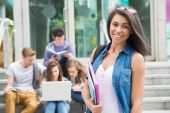 Pretty student smiling at camera outside — Stock Photo