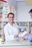 Pharmacist holding a prescription — Stock Photo