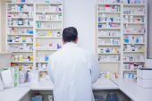 Rear view of a pharmacist working in lab coats — Stock Photo