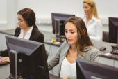 Focused businesswomen working in computer room — Stock Photo