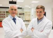 Science student and lecturer smiling at camera — Stock Photo