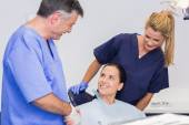 Dentist and nurse introducing a patient — Stock Photo