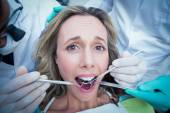 Close up of woman having her teeth examined — Stock Photo