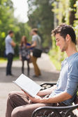 Handsome student studying outside on campus — Stock Photo