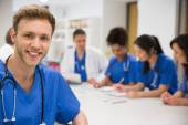 Medical student smiling at the camera during class — Stock Photo