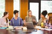 Female with students and teacher in library — Stock Photo