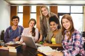 Student smiling at the camera with their teacher — Stock Photo