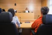 Lawyer and client listening to judge — Stock Photo