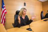 Stern judge speaking to the court — Stock Photo