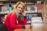 Smiling mature student studying at desk — Stock Photo