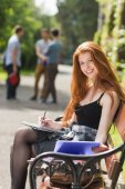 Pretty student studying outside on campus — Stockfoto