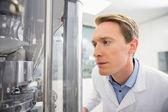 Focused pharmacist using advanced technology — Stock Photo