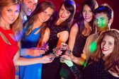 Happy friends on a night out together — Stock fotografie
