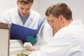 Science students using incubator in the lab — Stock Photo