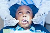 Close up of boy having his teeth examined — Stock Photo