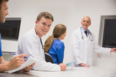 Medical professor teaching young students — Stock Photo