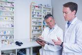 Pharmacists holding medication — Stock Photo