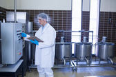 Focused biologist using the machine — Stock Photo