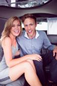 Happy couple smiling in limousine — Stock Photo