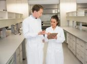 Team of pharmacists looking at clipboard — Stock Photo