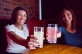 Happy friends toasting to camera — Zdjęcie stockowe