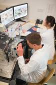 Biochemistry students using large microscope — Stock Photo