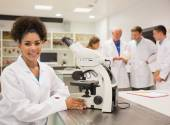Happy medical student working with microscope — Stock Photo