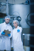 Food technicians working together — Stock Photo