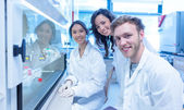 Science students using pipette in the lab — Stock Photo