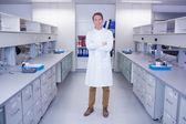 Smiling biochemist standing — Stock Photo