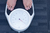 Close up of a woman standing on the scales — Stock Photo