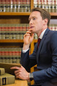 Handsome lawyer in the law library — ストック写真