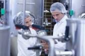 Biologist team talking and wearing hairnet — Stock Photo