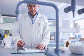 Focused biochemist preparing some medicine — Stock Photo