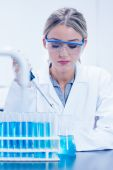 Science student using pipette in the lab — Stock Photo