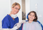 Smiling pediatric dentist and young patient — Stock Photo