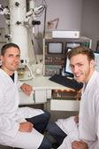 Biochemistry student using large microscope — Stock Photo