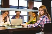 Student sitting at desk looking — Stock Photo