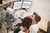 Biochemistry students using large microscope — Stock Photo