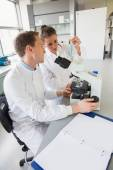 Young scientists working together — Stock Photo