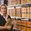 Serious lawyer holding a book — Stock Photo #65291175