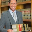 Lawyer reading book in the law library — Stock Photo #65291721