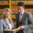 Lawyers reading book in the law library — Stock Photo #65292493