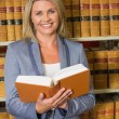 Lawyer holding book in the law library — Stock Photo #65294009