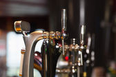 Beer pumps in a row — Stock Photo