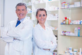 Pharmacist with his trainee standing — Stock Photo
