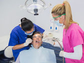 Dentist examining a patient  — Stock Photo