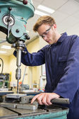 Engineering student using large drill — Stock Photo