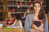 Pretty student holding books — Stock Photo